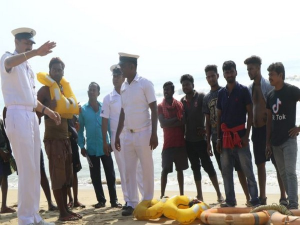 Indian Coast Guard personnel with locals on Odisha coast. Photo/ANI