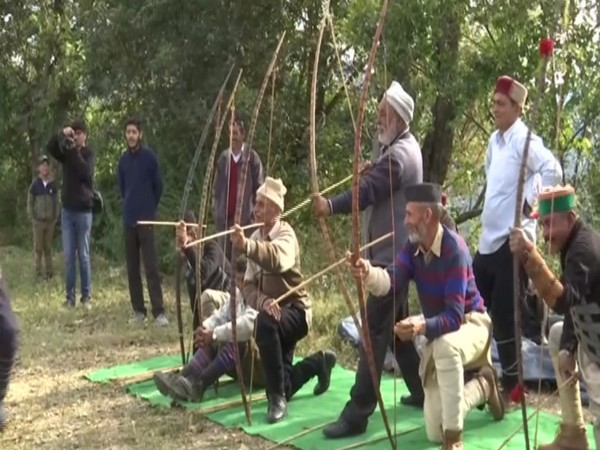 The festival begins with villagers performing prayers and the 'Thoda', a traditional sport of bow and arrow. Photo/ANI