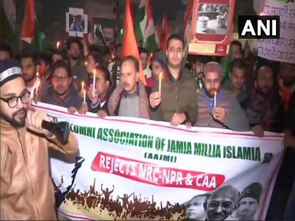 Alumni Association of Jamia Millia Islamia during the candlelight march on Wednesday at Jamia Nagar in New Delhi.