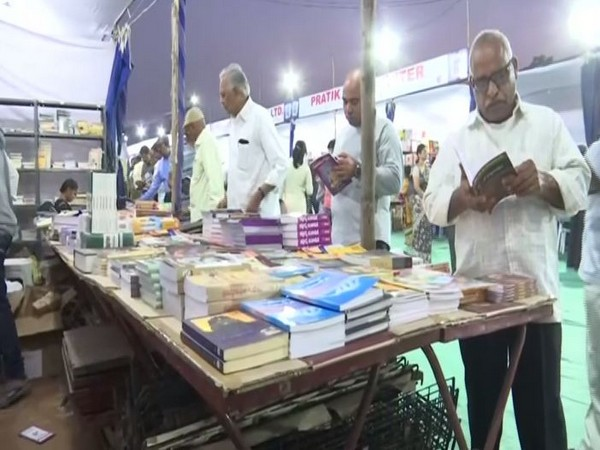 The visitors going on through different books on display in Telangana's Hyderabad book fair on Tuesday. Photo/ANI