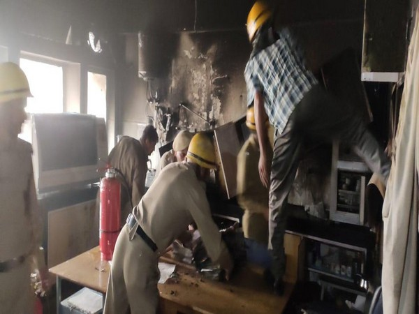Fire officials while carrying out cooling operations in Shimla on Wednesday. Photo/ANI