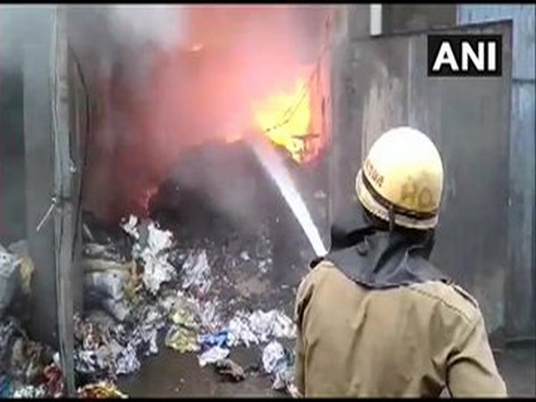 A fireman trying to douse the fire which broke out on Friday in Ludhiana. Photo/ANI