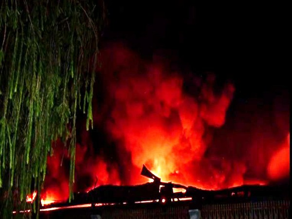 Flames rising out of the warehouse in Greater Noida on Monday. Photo/ANI