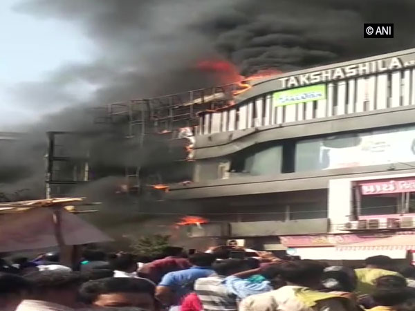 Visuals of the fire that broke out in Surat on Friday. Photo/ANI