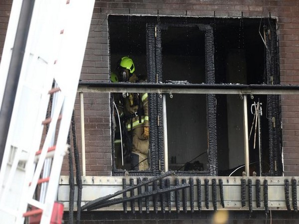 Firefighters work at the building where a fire broke out in Barking, London, Britain, on Sunday. (Photo/Reuters)