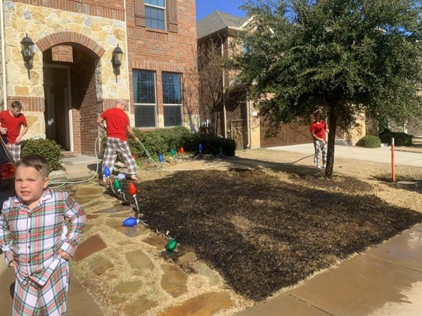 The Facebook photos and a video showed the couple working hard to douse the burning front yard (Picture Courtesy: Facebook)
