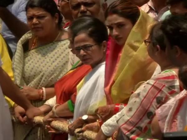 Mamata Banerjee and Nusrat Jahan pulling rope of Lord Jagannath chariot