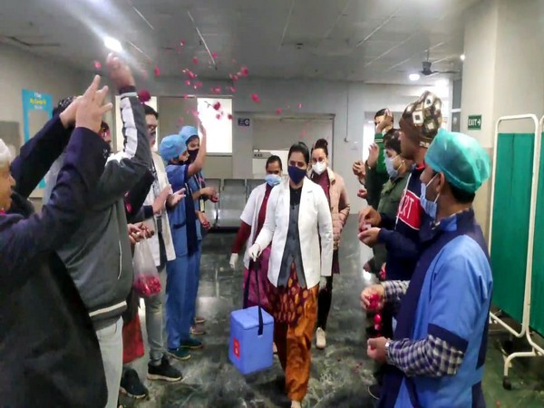 Healthcare workers being welcomed with shower of rose petals at a private hospital in Moradabad on January 28, 2021. (Photo/ANI)