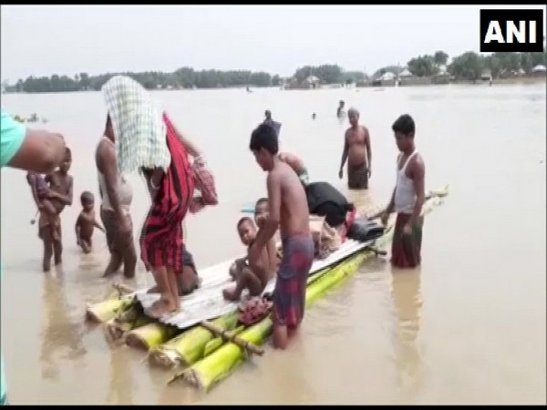 Visuals of villagers shifting to safe places due to flood in Bihar on Tuesday. Photo/ANI