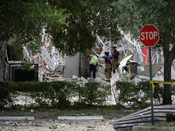 Fire officials inspect the affected area after an explosion at the Fountains shopping mall in Plantation, Florida on Saturday.