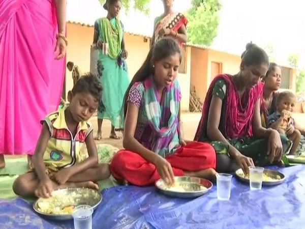 Food being served at an Anganwadi centre in Ganjenar village. Photo/ANI