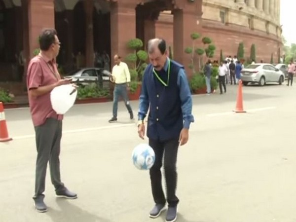 Trinamool Congress MP Prasun Banerjee playing football in Parliament on Thursday. Photo/ANI