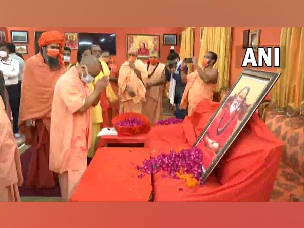 UP Chief Minister Yogi Adityanath pays his last respects to ABAP President Mahant Narendra Giri at the Baghambhari Math in Prayagraj