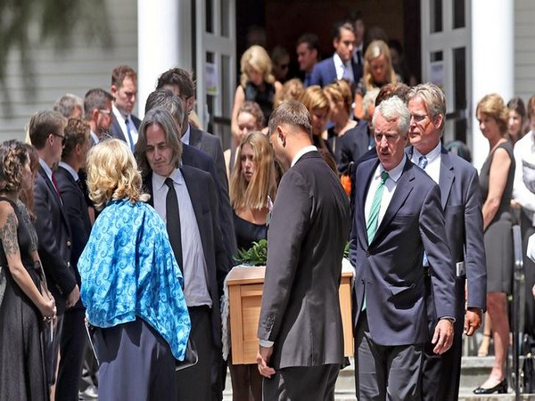 Courtney Kennedy Hill and Paul Michael Hill, carrying the casket along with other Kennedy family members, are seen after the funeral mass for their daughter Saoirse Kennedy Hill,