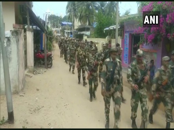 Visual of police and paramilitary forces' personnel flag march (Photo/ANI)