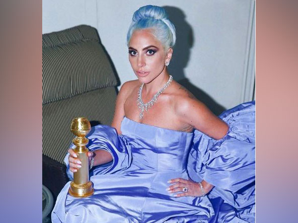 Lady Gaga wearing the Valentino periwinkle, off-the-shoulder gown (Image courtesy: Instagram)