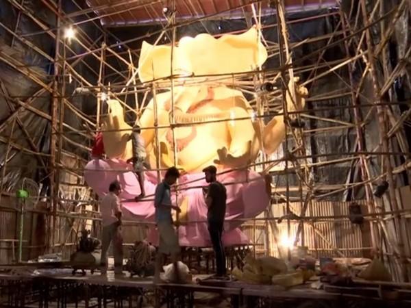 Labourers working in constructing the 22 ft long idol of Lord Ganpati in Mumbai