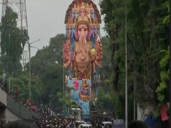 The devotees immersed the tallest idol -- Khairatabad Ganesh -- in Hussain Sagar Lake on Thursday. Photo/ANI