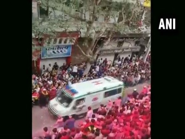 Devotees made way for an ambulance during Ganesh idol immersion