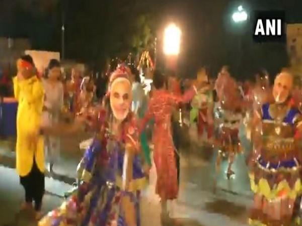 People performing 'Garba' while wearing Modi masks in Gujarat's surat on Friday. Photo/ANI