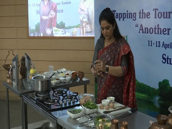 Visual of Pankaj Bhadouria giving a live demonstration of her cooking skills in Kashmiri cuisine