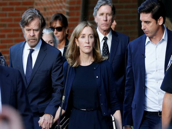 Felicity Huffman leaving the federal courthouse with husband William H. Macy (Picture courtesy: Reuters)