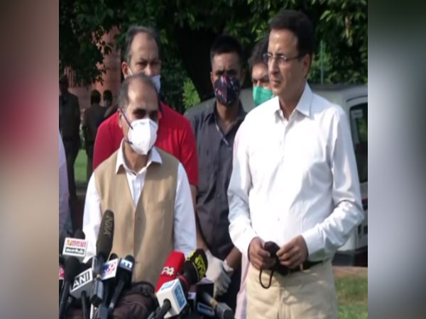 Congress leaders Adhir Ranjan Chowdhury (left) and Randeep Singh Surjewala addressing media persons in New Delhi on Tuesday. [Photo/ANI]