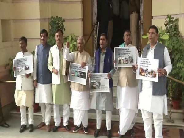 RJD leader Ramchandra Purvey (fourth from the right) staged protest in Bihar Assembly premises on Tuesday in Patna. Photo/ANI