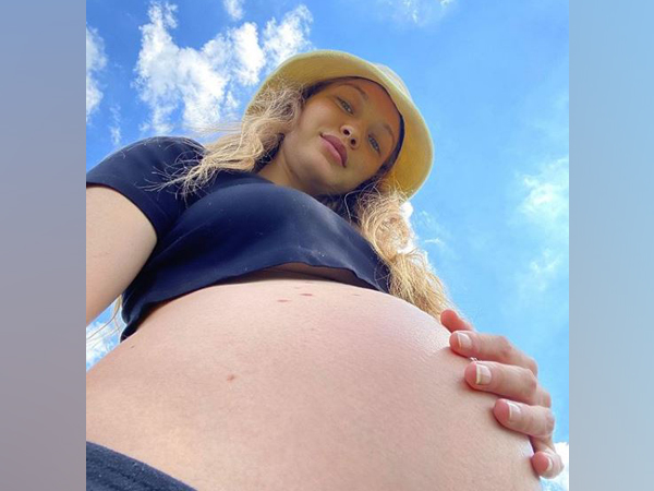 Pregnant Gigi Hadid shows off her baby bump. (Image courtesy: Instagram)
