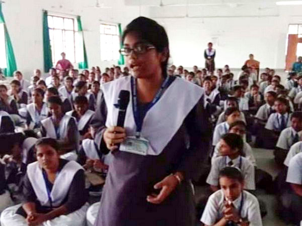 A schoolgirl questioning police official at awareness programme at Barabanki on July 31. Photo/ANI