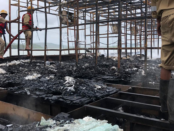 Fire fighters in the Bar ca De Festa houseboat on Friday in North Goa. Photo/ANI