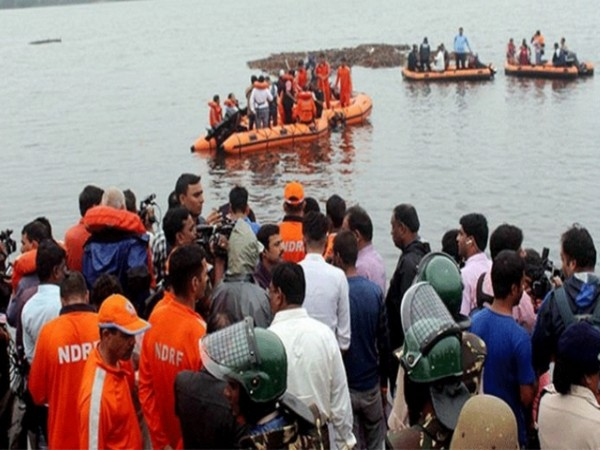 Visuals from the rescue operations in progress in the Godavari boat capsize incident. Photo/ANI