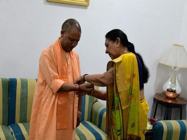 Uttar Pradesh governor Anandiben Patel tied rakhi on the wrist of Chief Minister Yogi Adityanath while celebrating Raksha Bandhan on Thursday. Photo/ANI