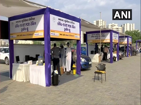 Drive-through RT-PCR testing launched at GMDC Ground in Ahmedabad  today. (Photo/ANI)