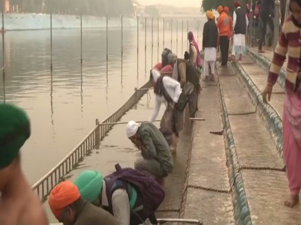 Devotees takes holy dip at the river near Ber Sahib Gurudwara on Guru Nanak Jayanti. Photo/ANI