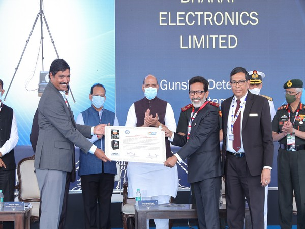 Director of Engineering and Research and Development Arup Chatterjee receiving the clearance certificate from Chief Executive of CEMILAC V S Prasad