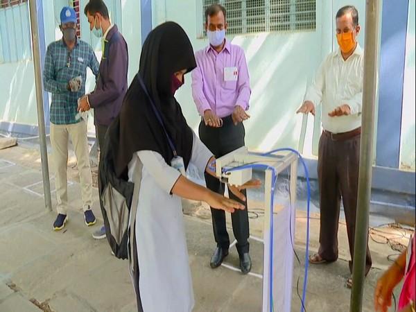 Three engineering students developed a sensor-enabled touchless hand sanitizer in Shivamogga, Karnataka. (Photo/ANI)