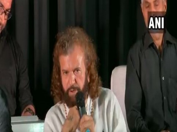BJP MP and artiste Hans Raj Hans speaking at an event in JNU, New Delhi on Saturday. (Photo.ANI)