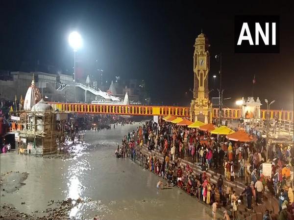 Devotees took a holy dip in river Ganga in Haridwar on 'Mauni Amavasya'. (Photo/ ANI)