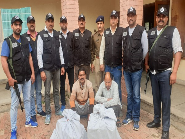 The arrested accused in police custody along seized over 66K banned tablets and 40 boxes of illicit liquor. Photo/ANI