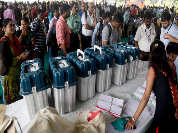 Polling staff getting the EVMs and other polling materials to take them to the polling stations on the eve of assembly elections at Jogeshwari in Mumbai on Sunday. (ANI Photo)