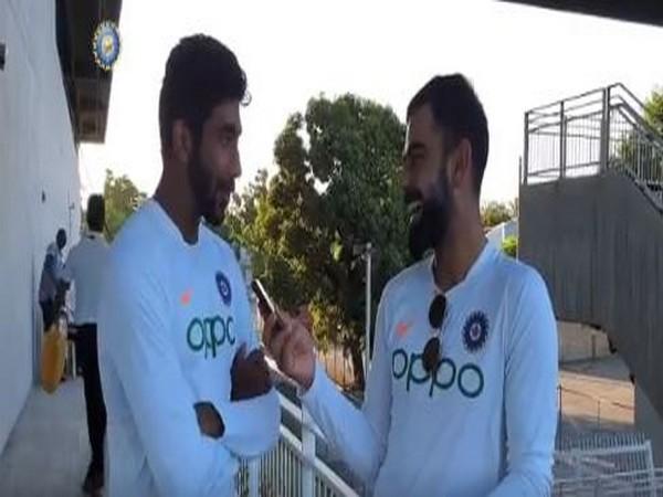 India skipper Virat Kohli in conversation with Jasprit Bumrah (Photo/BCCI Twitter)