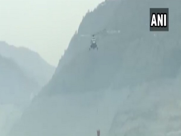 Indian Air Force's helicopter participating in fire fighting operations of Tehri Garhwal. (Photo/ANI)
