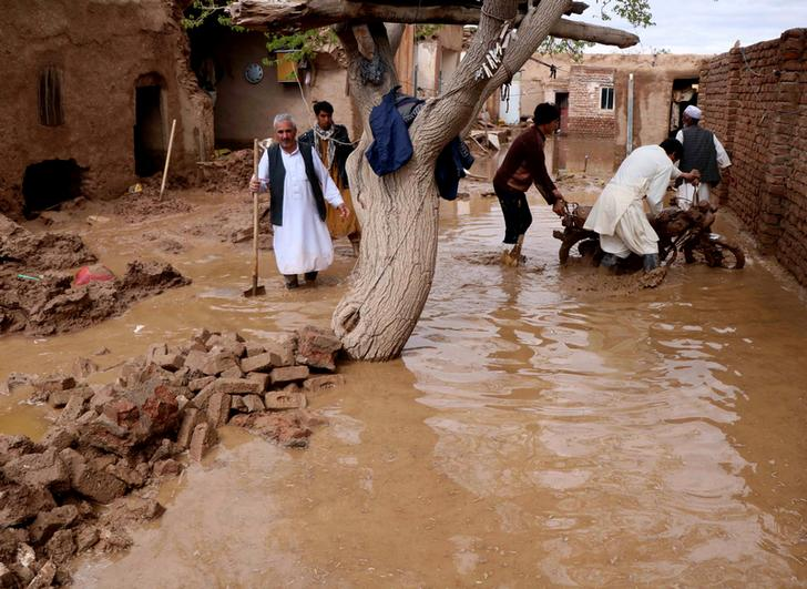Locals trying to salvage their belongings from flood-affected homes in Herat, Afghanistan on March 30 (Image Source: Reuters)