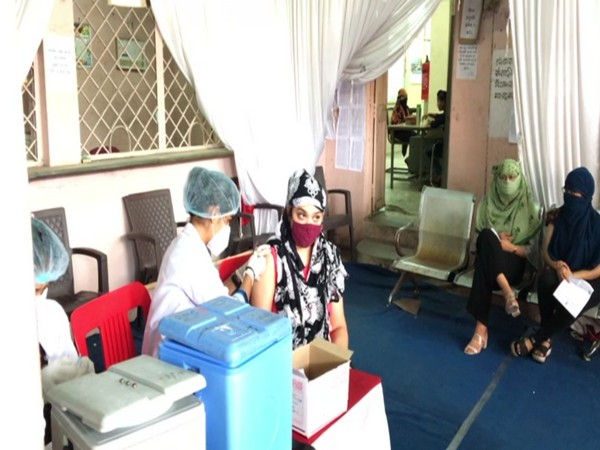 A woman receiving COVID vaccine jab at an innoculation centre in Indore (ANI).