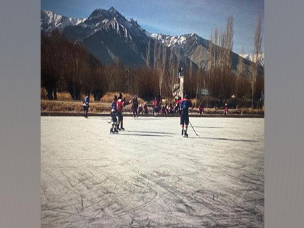 Athletes playing ice hockey