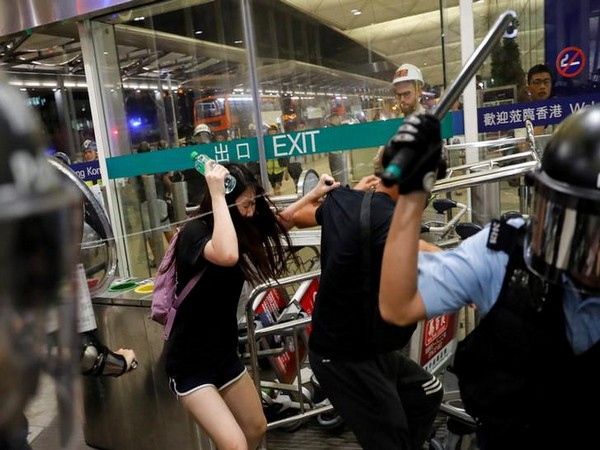 Violent clashes broke out between police in riot gear and protesters at Hong Kong's airport on Tuesday.