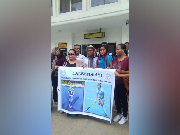 Indian women's hockey team forward Lalremsiami received by the villagers.