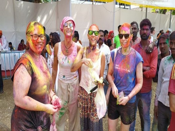 Foreign tourists celebrate Holi with locals