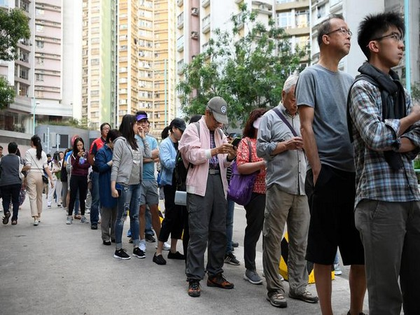 People line up to vote in district council elections in South Horizons in Hong Kong on Sunday.